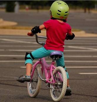 Teaching kids to ride their first bike