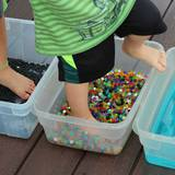 Using feet for sensory play activities